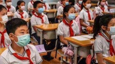 চীনে প্রাথমিক স্কুল থেকে করোনার নতুন প্রাদুর্ভাব